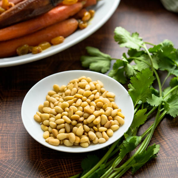 toasted pine nuts and cilantro for garnishing the Moroccan heirloom sous vide carrots.