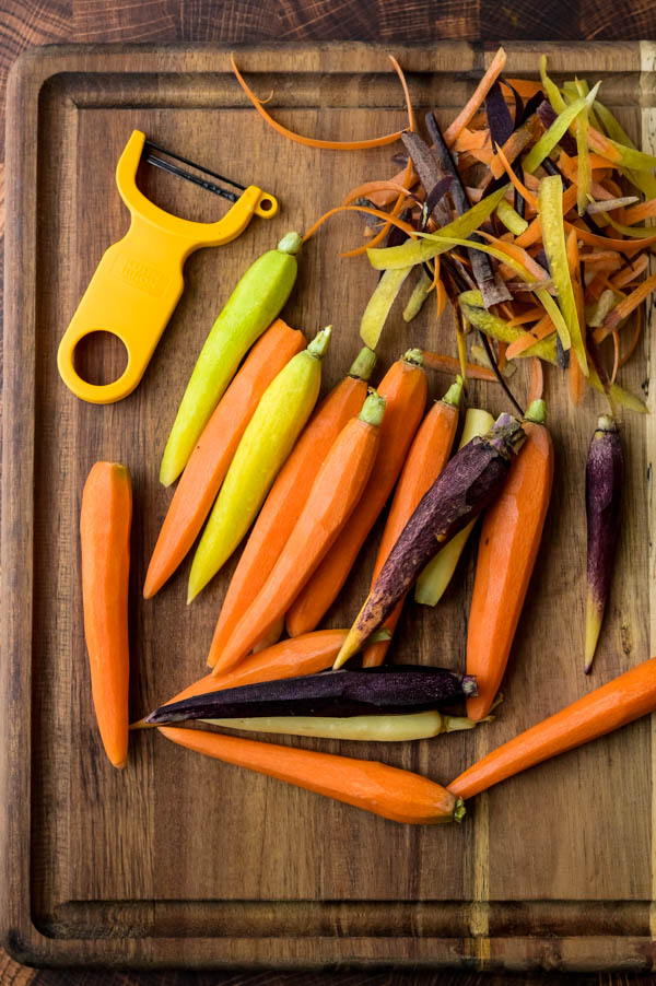 peeling and trimming heirloom carrots for sous vide cooking.