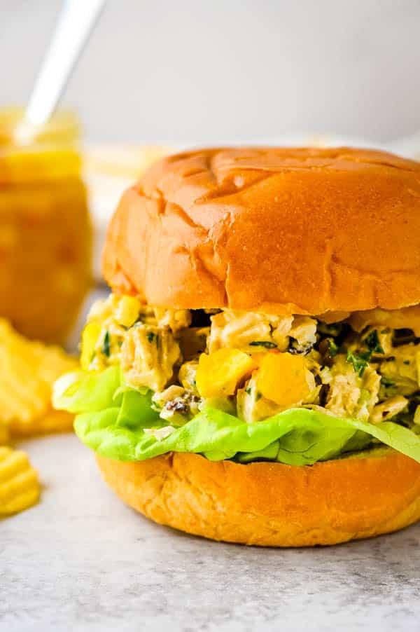 chutney mango chicken salad on a brioche roll.