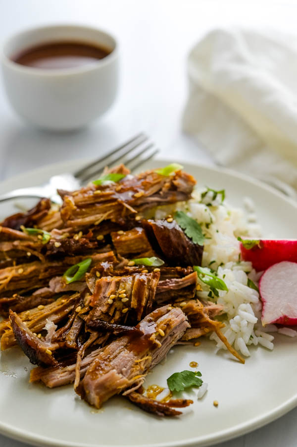 Serving Asian pulled pork over sticky rice.