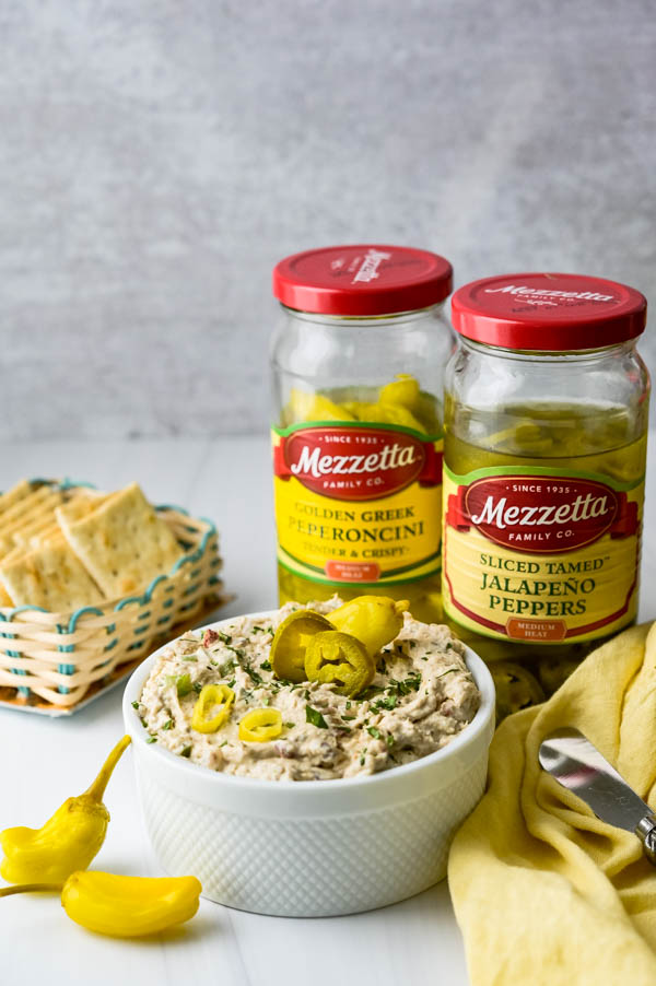 Garnishing the smoked whitefish dip with Mezzetta pickled jalapenos and slices of pepperoncini.