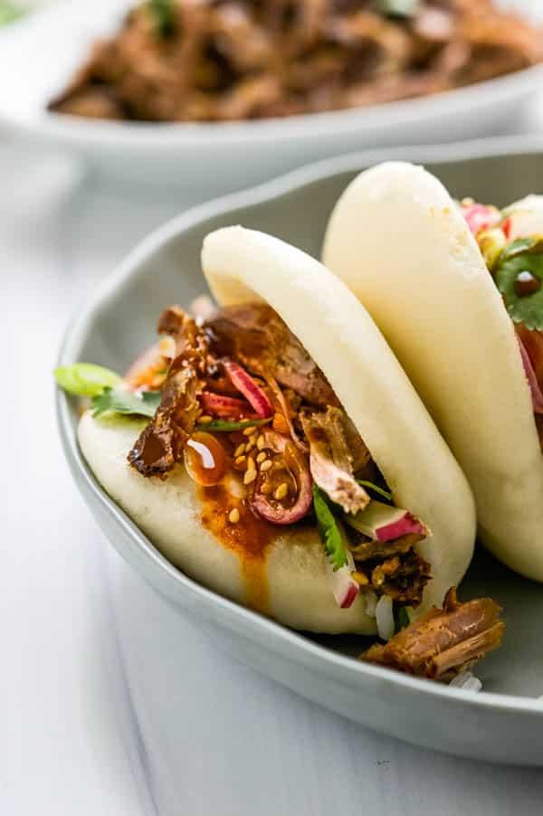 pulled pork bao on a platter to serve.