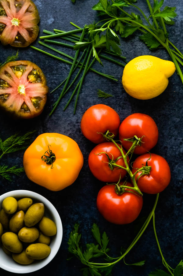 heirloom tomatoes, fresh herbs and olives.