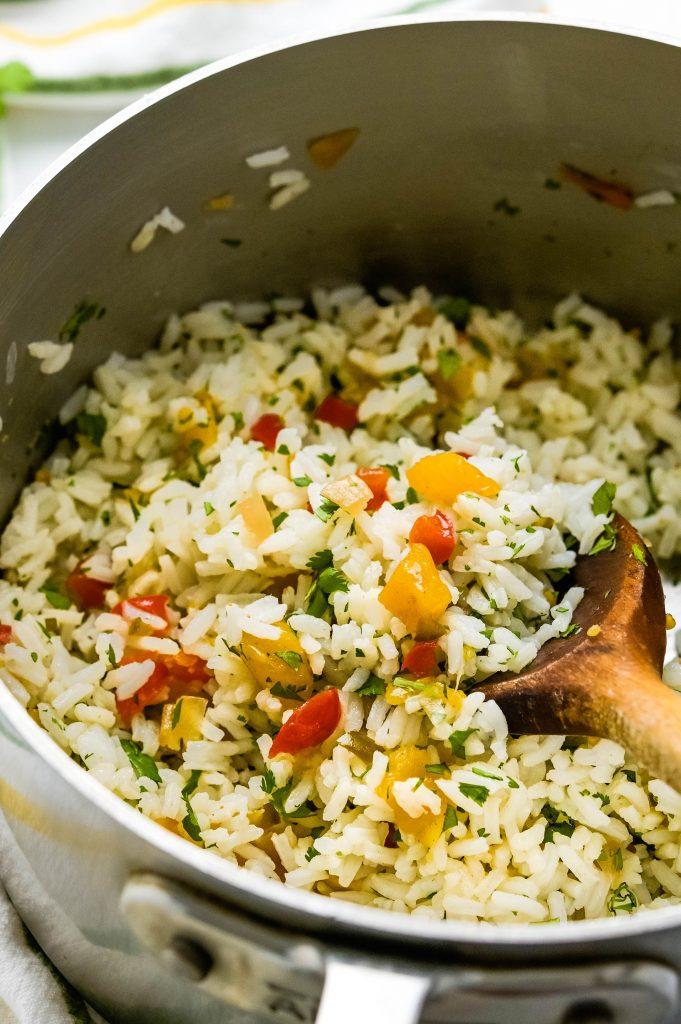 Stirring pineapple rice recipe in the pot.