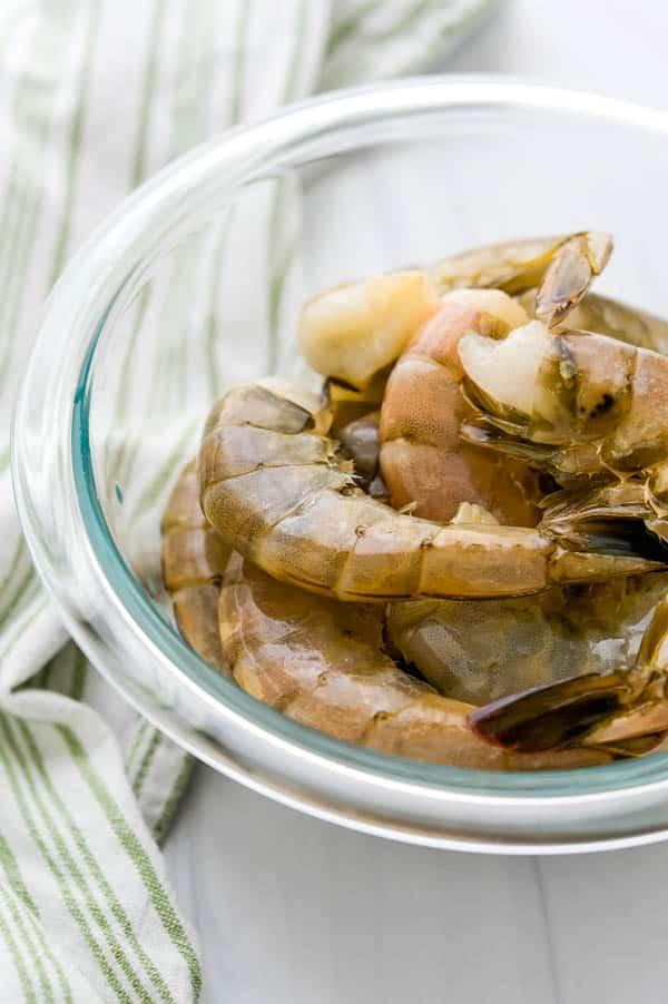 a bowl of fresh extra large shrimp.
