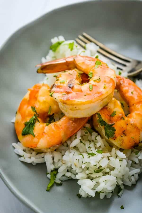 Serving pineapple bourbon shrimp over rice.