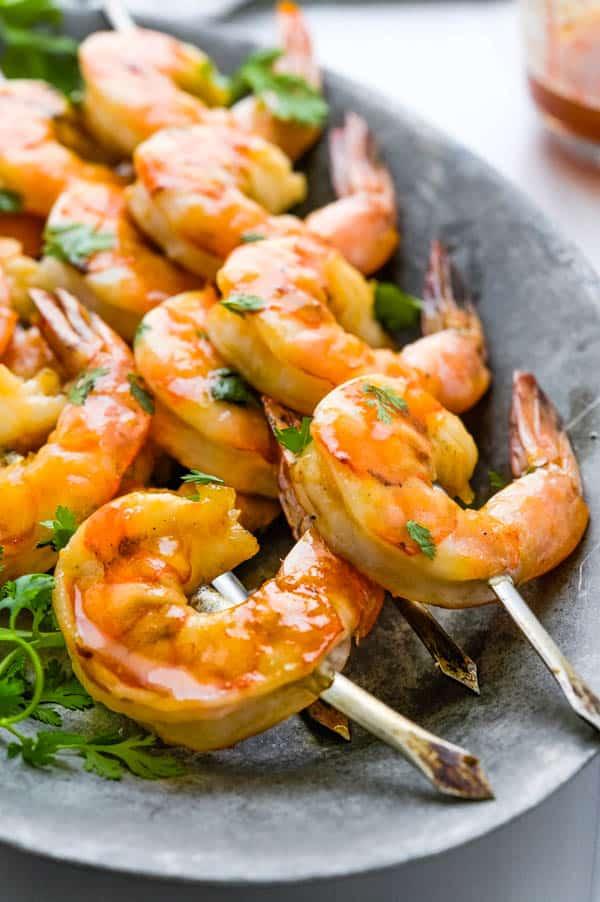 serving pineapple bourbon glazed shrimp on a platter.