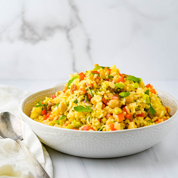 Serving curried rice salad.