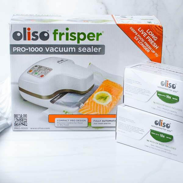 The Oliso Frisper and storage bags.