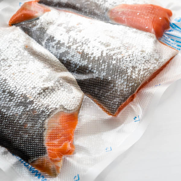 salmon fillets vacuum sealed in a bag.