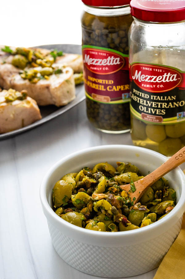 Serving olive relish with the swordfish steaks.