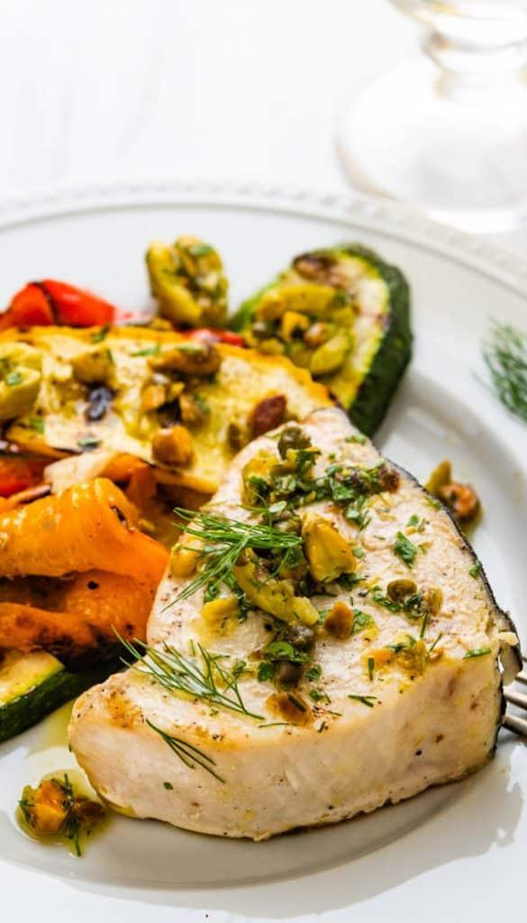 Serving grilled swordfish steaks with castelvetrano olive relish.