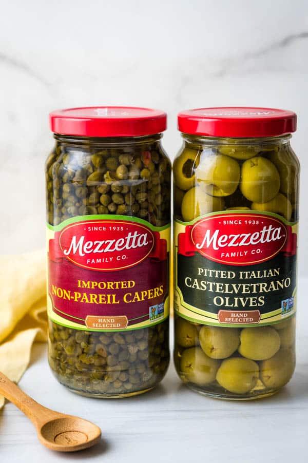 Jars of Mezzetta Capers and Castelvetrano olives.