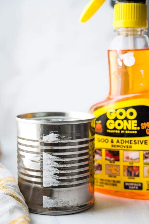 Removing the  wrapper from Sweetened condensed milk in a can.