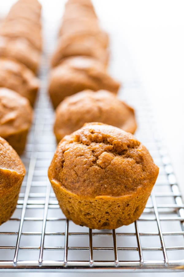 Cool the spiced pumpkin muffins on a wire rack before dunking in maple glaze.