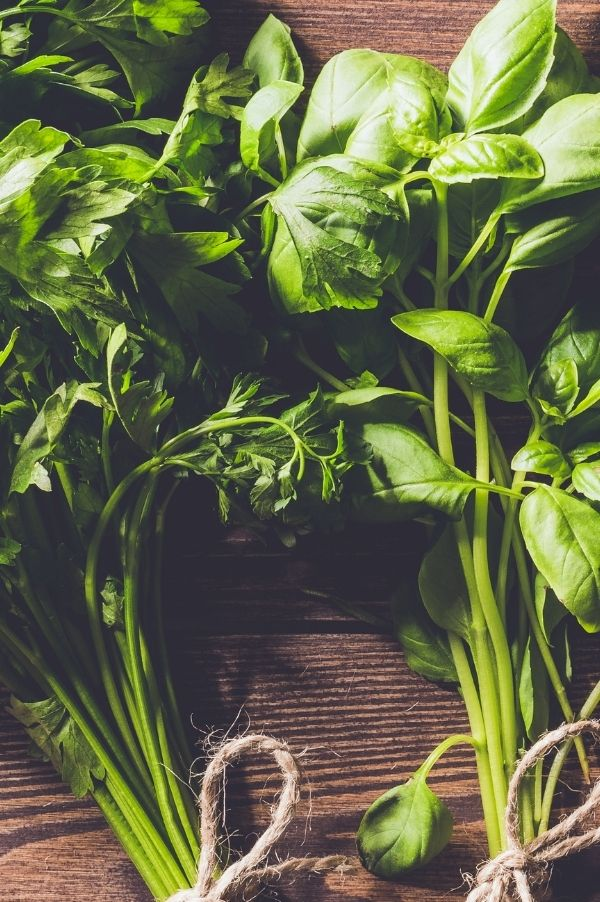 fresh herbs like basil and parsley add brightness to a canned spaghetti sauce.