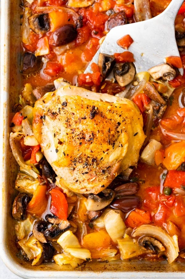 Crispy skinned chicken thighs on a bed of roasted cacciatore style vegetables.