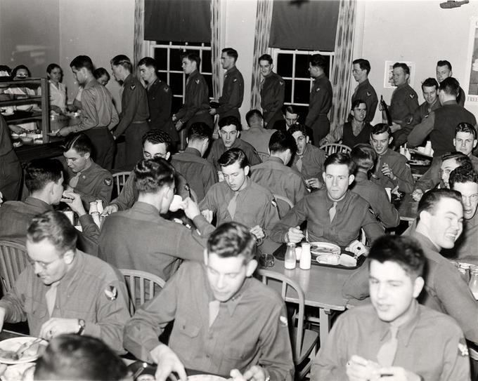 Image of military men eating in a mess hall.