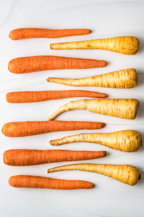 carrots and parsnips intersecting in a straight line.