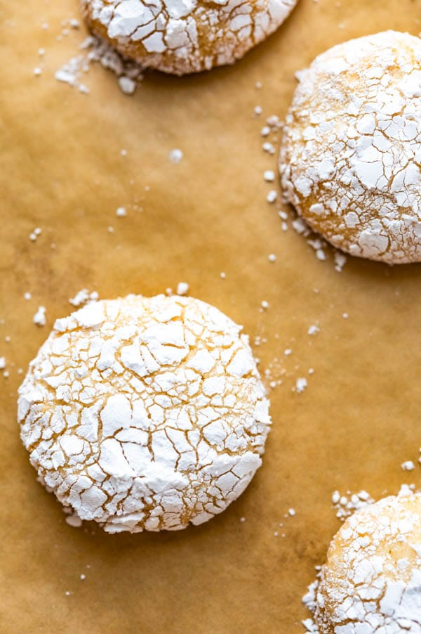 baked Italian almond cookies on parchment paper.