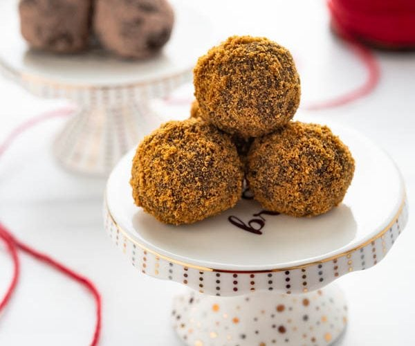 A pyramid of bourbon gingerbread chocolate truffles on a mini cake stand.