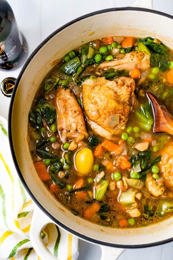 A pot of Irish stout braised chicken with potatoes, escarole and peas.