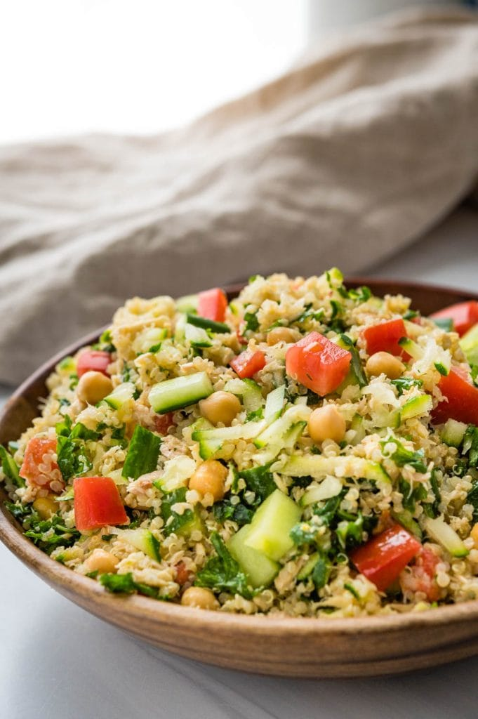 A large bowl of freshly made chickpea tuna salad with quinoa and kale.