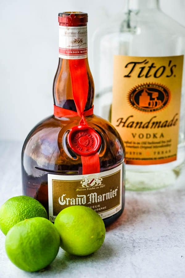 Grand Marnier, vodka and limes for the white cosmopolitan cocktail.