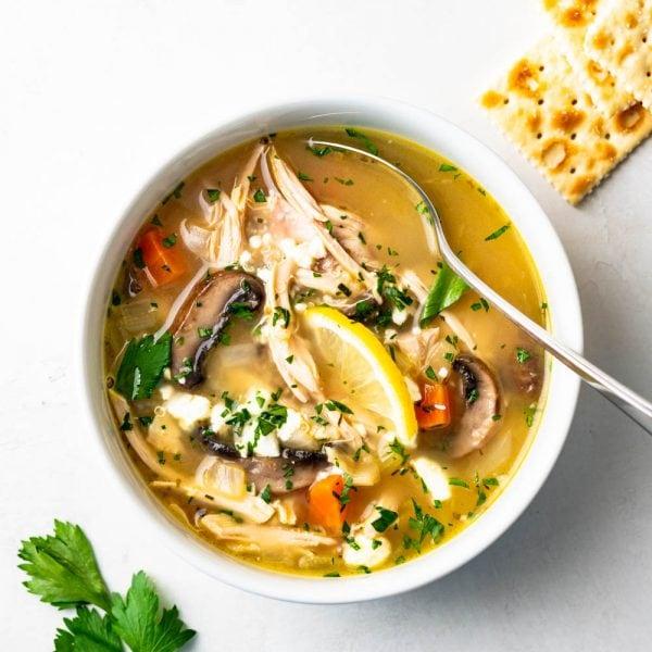 Lemon chicken greek soup in a bowl.