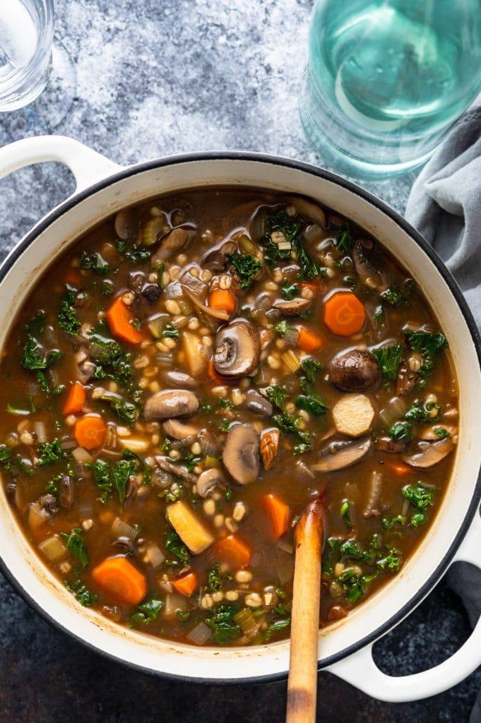 a pot of barley mushroom vegetable soup.