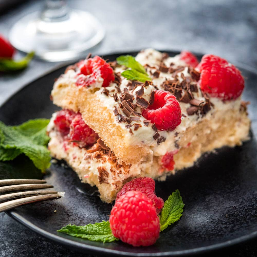 a serving of raspberry tiramisu on a plate.