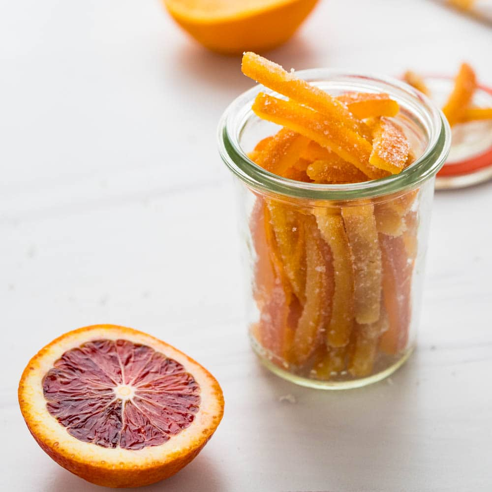 Candied citrus peel in a glass jar.