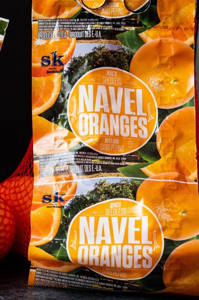 a bag of Sunkist Navel oranges.