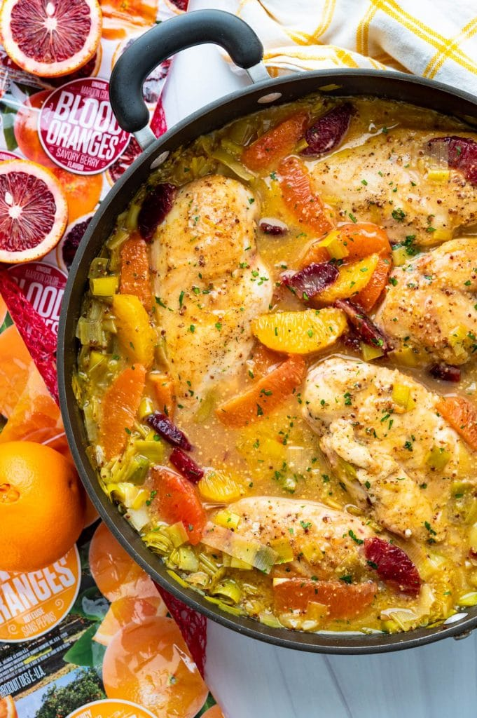 a pan of simmered orange chicken in a skillet.
