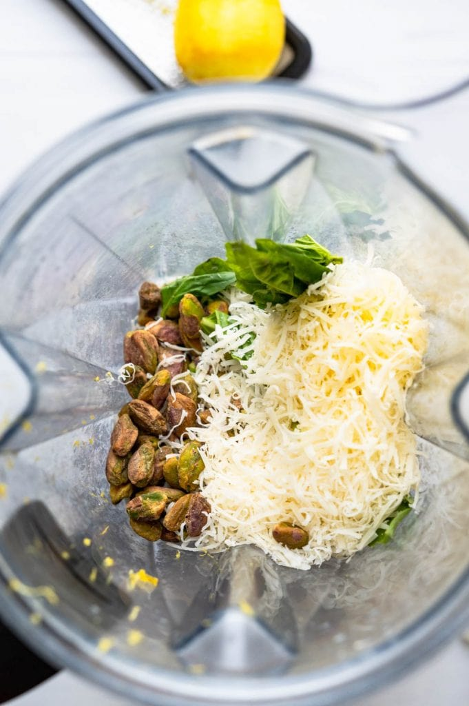 adding parmesan cheese and nuts.