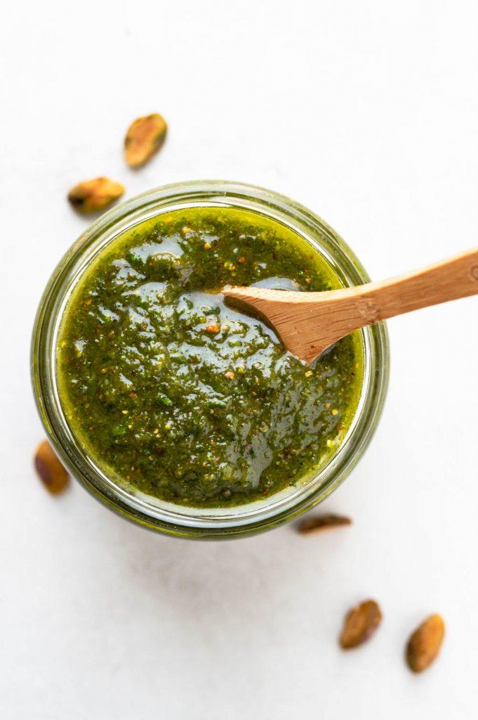 Basil pistachio pesto in a jar.