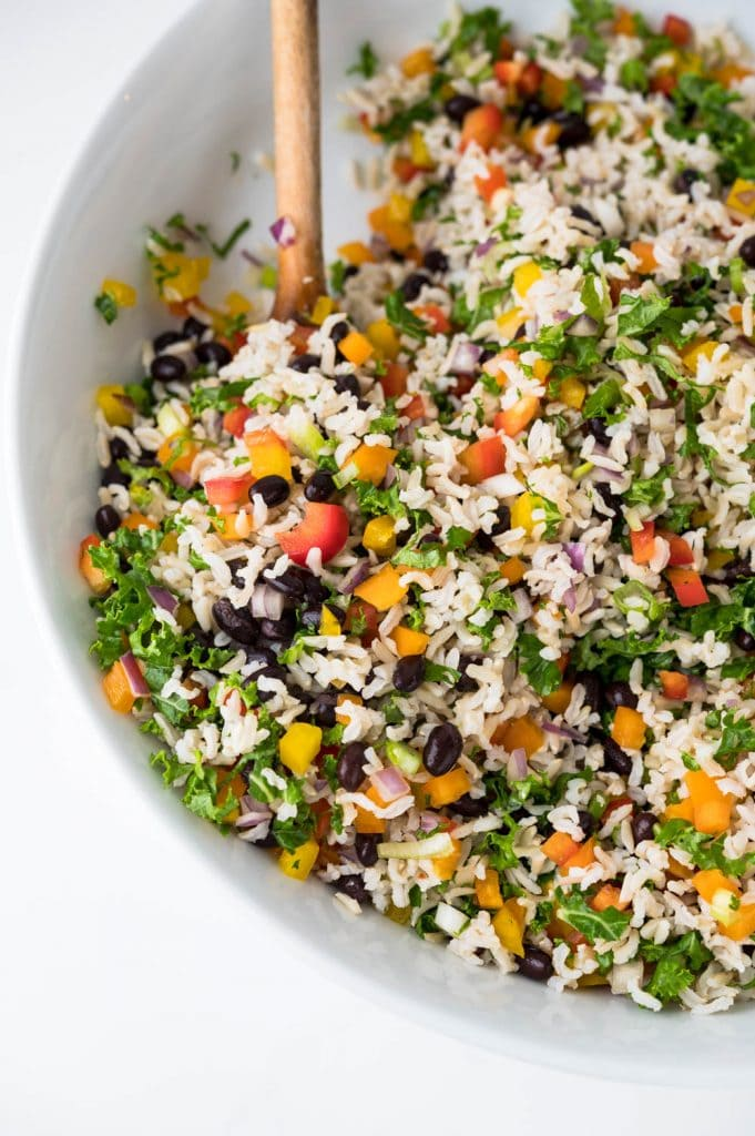 Serving black bean and brown rice salad in a large bowl.