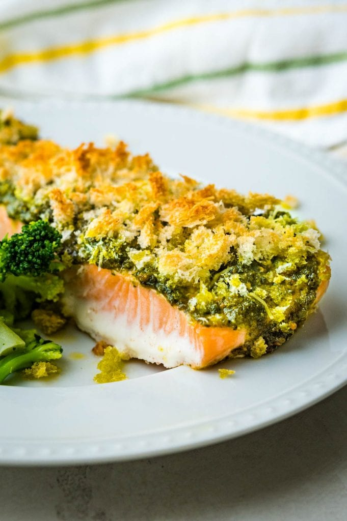 Serving pesto crusted salmon with broccoli.