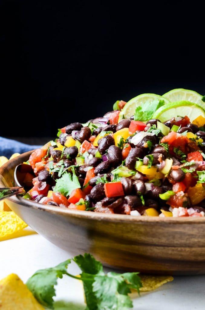 a big bowl of black bean dip with tortilla chips.