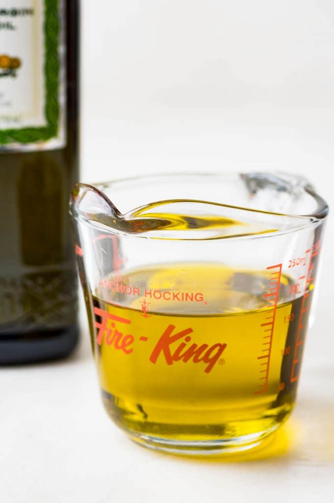 olive oil in a measuring cup.