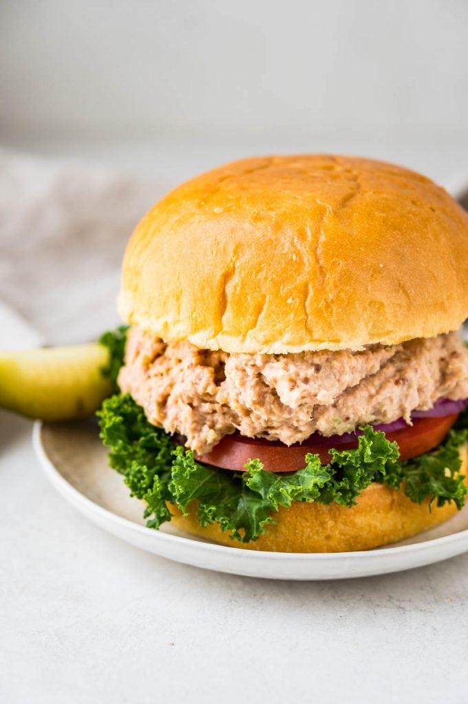 making a ham salad sandwich.