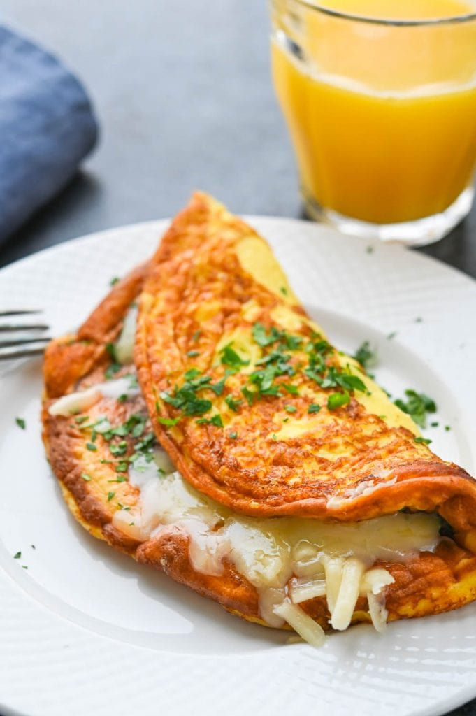serving cheese omelette on a plate.
