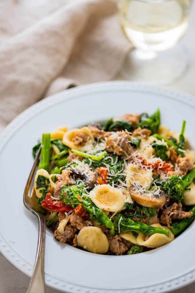 serving orecchiette, sausage and broccoli rabe.