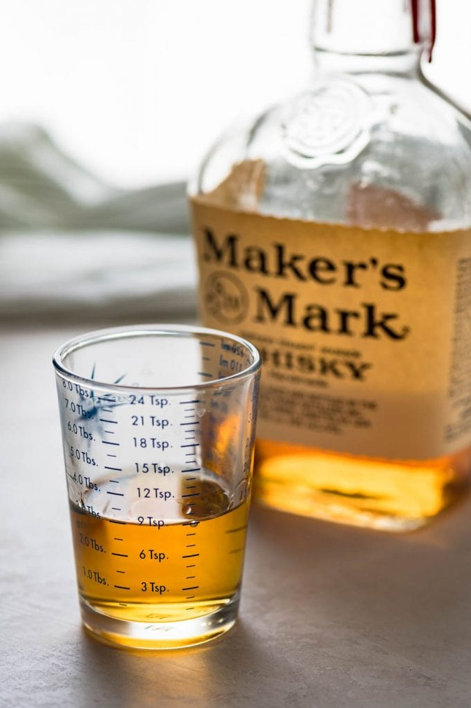 a bottle of Maker's Mark bourbon measured out to 3 tablespoons.