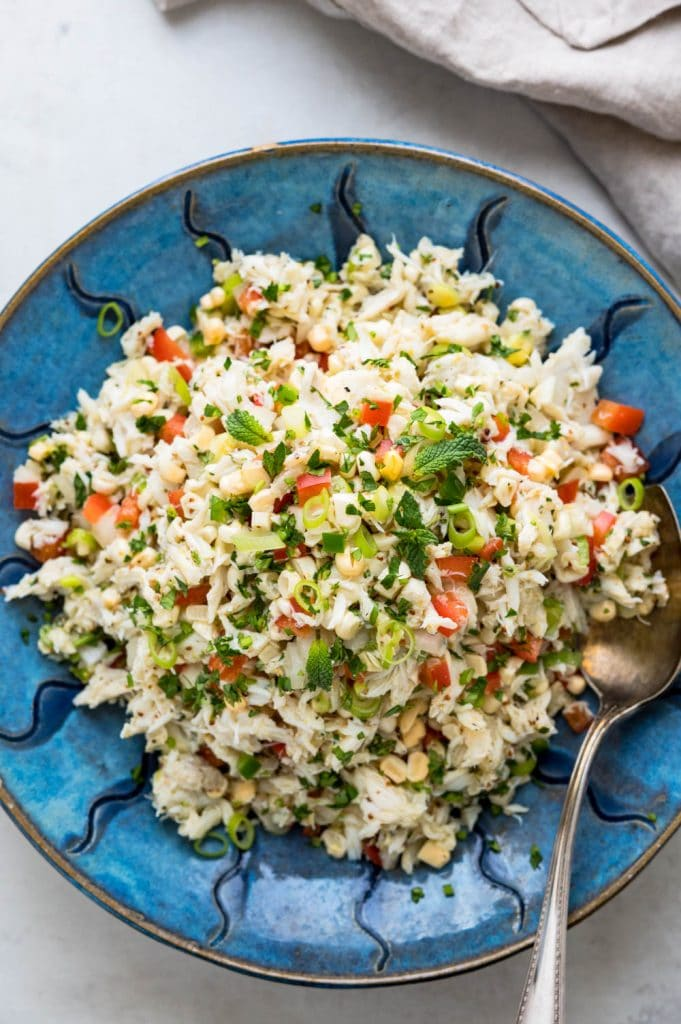 Serving corn and lump crab salad in a bowl.