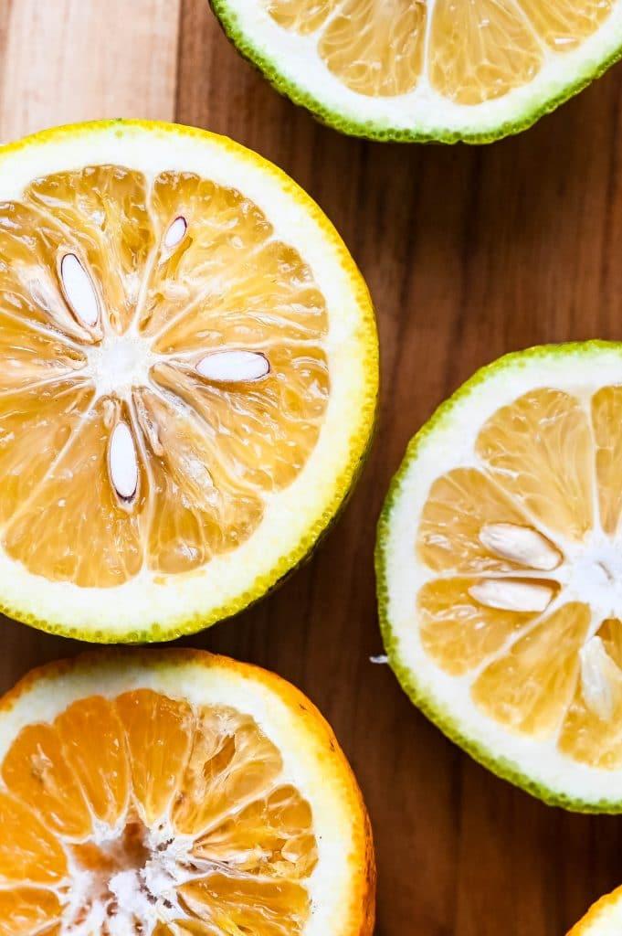 sour oranges cut in half.
