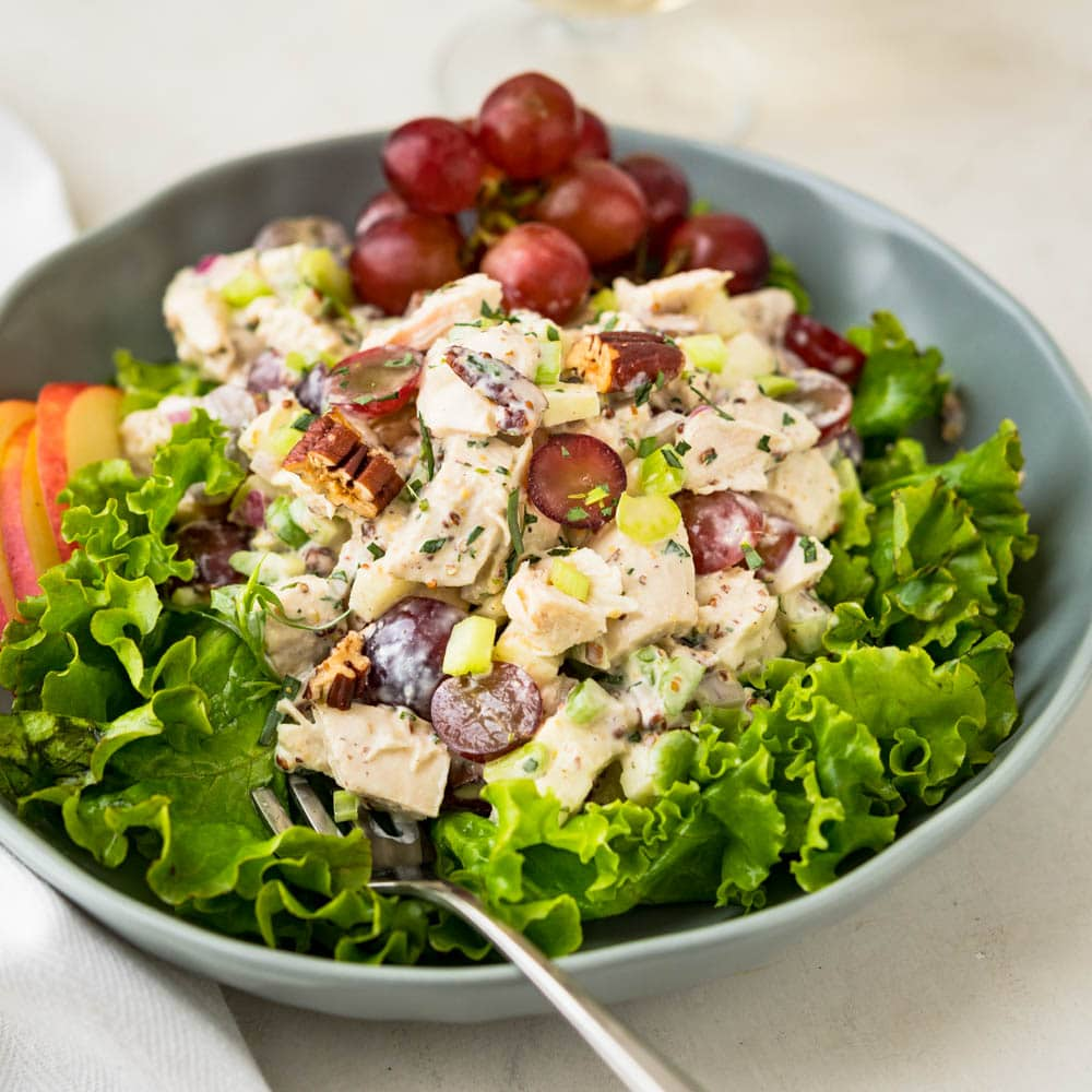 Waldorf chicken salad on a bed of lettuce.