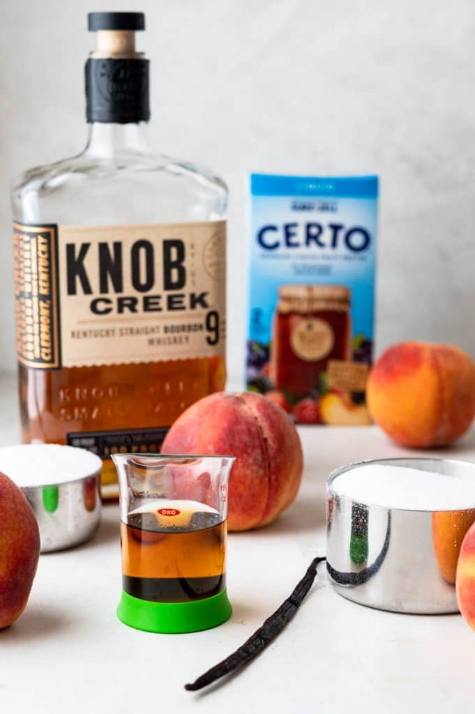 ingredients needed for bourbon peach jam with pectin.