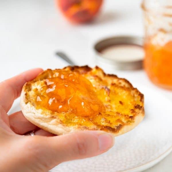 a muffin with fresh peach jam.