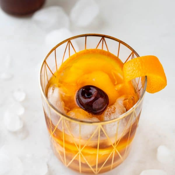 holiday old fashioned in a rocks glass with garnish.